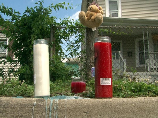 Asbury Park — A memorial is shown on Sewall Avenue Wednesday, June 17, 2015, where an off-duty Neptune police officer is accused of shooting and killing his former wife.