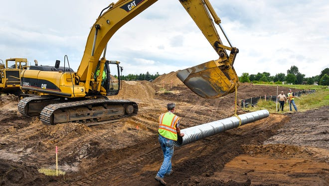 Workers from Schendzielos & Sons Excavating, Clear Lake, install culverts and prepares the driveway Wednesday, Aug. 9, at the new B&F Fastener Supply building at 23668 67th Ave., St. Augusta.