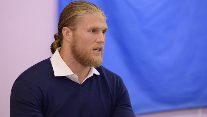 Clay Matthews of the Green Bay Packers talks about fighting domestic violence during a press conference Tuesday at Wise Women Gathering Place in Ashwaubenon.