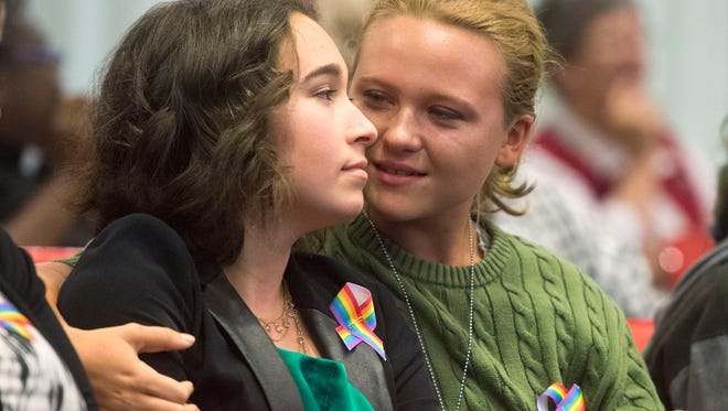 "Bearden High School student Bailey Burroughs, left, is supported by partner Maddie Vinson after Burroughs spoke before the Knox County Board of Education against proposed changes to the school system's harassment policy of removing ""actual or perceived gender"" and ""sexual orientation"" from a list of protected groups."