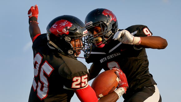 North Central's George Stokes (25),left, celebrates