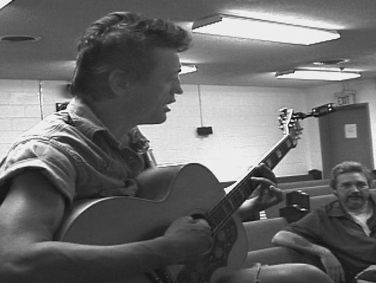Mark Collie plays guitar in the chapel at Brushy Mountain