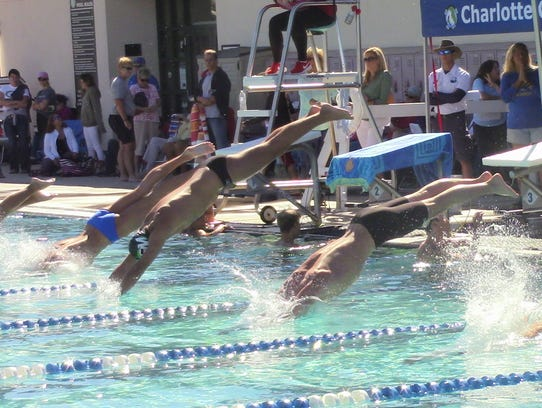 Fort Myers' Michael Brent (middle) competes in Thursday's