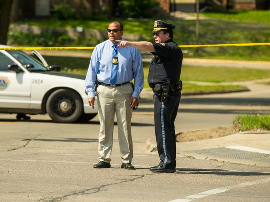 Des Moines Police investigate a shooting Tuesday, May 9, 2017, at the intersection of 30th and Hickman near Monroe Elementary School.