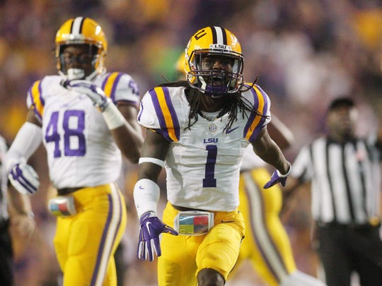 LSU Tigers defensive back Donte Jackson (1) celebrates a turnover agains the Texas A&M Aggies in the first quarter at Tiger Stadium.