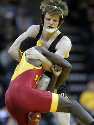 Cory Clark wrestling against Iowa State earlier this season.