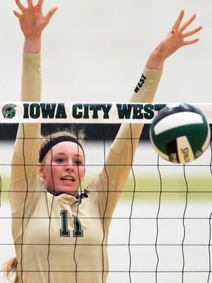 West High's Emily Halverson blocks a shot during the Women of Troy's game against Cedar Rapids Kennedy on Tuesday, Sept. 22, 2015.