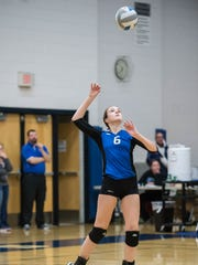 Harper Creek's Kim Kusler serves the ball during regional