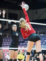 Plymouth Christian's Aliyah Pries (9) attampts to block a kill shopt by St. Philip's Abby McKinzie.