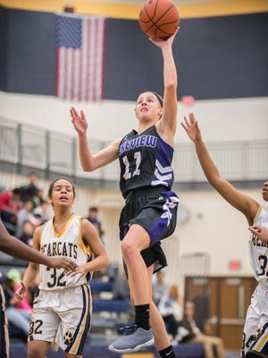 Lakeview's Ava Cook (11) takes a running floater against Battle Creek Central Friday evening.