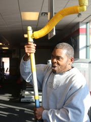"Denard Bailey of Detroit demonstrates  ""The Body Crank""  that helped him go from over 400 pounds to losing more than 200 pounds Wednesday, Nov. 11, 2015 at Snap Fitness in Roseville.  Thompson created this equipment and it helped his friend lose the weight. They worked together to perfect it and take it to the next level."