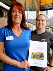From left, Michele Vanderyacht and Sheena Williams show off a poster for a self-defense class at Epic Fitness on Saturday, Feb. 6 that will benefit the canine unit of the Marion County Sheriff's Office.