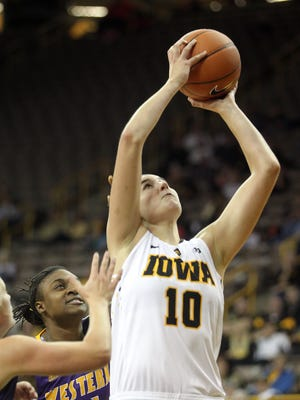 Iowa's Megan Gustafson takes a shot during the Hawkeyes' game against Western Illinois at Carver-Hawkeye Arena on Thursday, Nov. 19, 2015.