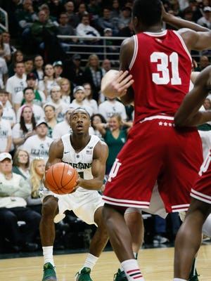 Michigan State Spartans guard Tum Tum Nairn, Jr. looks to shoot against the Indiana Hoosiers at the Breslin Center in East Lansing on Feb. 14, 2016.