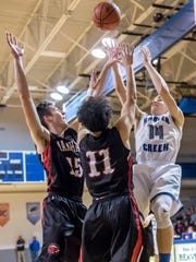 Marshall's T.J. Rocco (15) and Tyler Torrey (11) guard