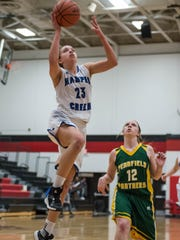 Harper Creek's Charley Andrews (23) goes for the layup
