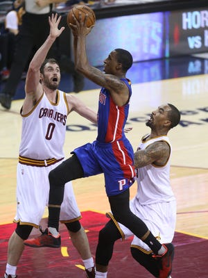 Detroit Pistons' Kentavious Caldwell-Pope drives against the Cleveland Cavaliers' Kevin Love and J.R. Smith on Sunday, April 17, 2016 at Quicken Loans Arena in Cleveland.