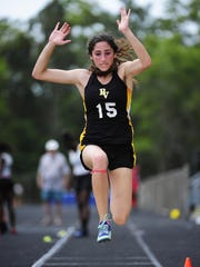 Bishop Verot's Sophia Shahriari competes in the girls long jump during the 2A-12 district track and field final Friday, April 22, 2016 at Lely High School in Naples, Fla. Teams from Collier, Lee and Hendry counties came to compete to advance to regionals. (Corey Perrine/Staff)