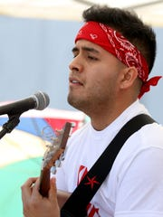 Aldo Solano, 23, of Woodburn, performs during the May