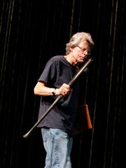 Author Stephen King holds a bat given to him by Charmichael's Bookstore at a 2016 forum in Louisville.