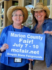 From left, Mary Grim and Lisa Miller need volunteers to assist at the upcoming Marion County Fair.