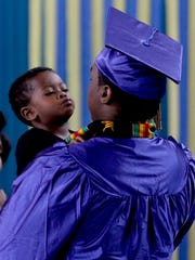 Devante J. gets a kiss from his son, Jakeem, 23 months, following a graduation ceremony for the Oregon Youth Authority at the Hillcrest Youth Correctional Facility in Salem on Wednesday, June 29, 2016. This is the last-ever graduation at Hillcrest before the facility is closed and students and staff are transferred to MacLaren in Woodburn by this time next year.