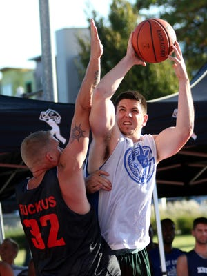 Cody Crowe, right, takes a shot past Rick Smart during the Hoopla 2x2 Tip-Off tournament at the Salem Convention Center on Wednesday, Aug. 3, 2016. The 18th annual Oregon National Guard Hoopla is one of the nation's largest 3-on-3 basketball tournaments.
