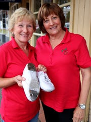 Cherry City Cloggers, from left, Jan Fiedler and Pam Secrest, show off the taps on shoes used to clog. A new beginner's class starts this month.