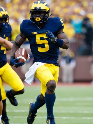 Sep 10, 2016; Ann Arbor, MI, USA; Michigan Wolverines linebacker Jabrill Peppers  runs the ball on a punt return in the second quarter against the UCF Knights at Michigan Stadium.