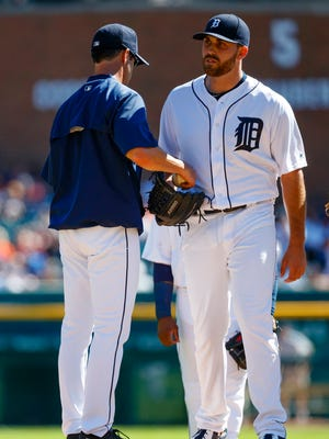 Tigers manager Brad Ausmus (7) takes the ball to relieve pitcher Matt Boyd (48) in the first inning Sunday at Comerica Park.