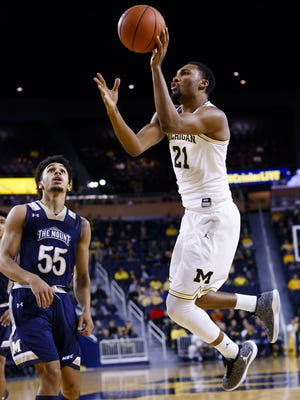 Michigan's Zak Irvin goes to the basket against Mount St. Mary's Elijah Long on Saturday. Irvin scored 14 points in the Wolverines' 64-47 win.