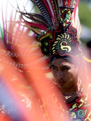 A Titlakawan Azteca dancer performs at the 19th annual World Beat Festival at Riverfront Park in Salem on Sunday, June 26, 2016.
