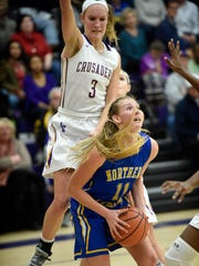 Viking Megan Brandt gets ready to go for two of her 21 points while being guarded by Lancaster Catholic's Lauren Mills.
