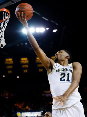 Feb 16, 2017; Ann Arbor, MI, USA; Michigan Wolverines guard Zak Irvin shoots in the first half against the Wisconsin Badgers at Crisler Center.