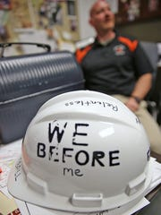 The hard hat and lunchbox are coaching cliches says Matt English. You bring them to work with you every day. When English is down he reads some of the heartfelt notes.