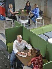Employees gather to talk and collaborate in the atrium at First Internet  Bank in Fishers,