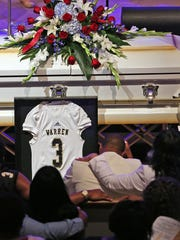 A #3 Warren Central jersey adorns the casket of football star Dijon Anderson during the Celebration of Life for him, at Caring Place, May 31, 2017.