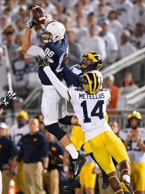 Penn State TE Mike Gesicki (88) makes a catch in front of Michigan DB Josh Metellus (14) during the first quarter on Saturday, October 21, 2017 at Beaver Stadium in University Park, Pa.
