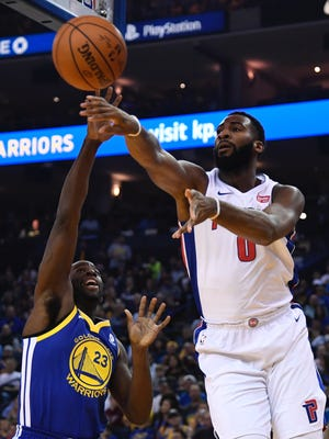 Pistons center Andre Drummond (0) passes the basketball against Warriors forward Draymond Green (23) during the first quarter on Sunday, Oct. 29, 2017, in Oakland, Calif.