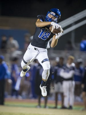 Wide receiver Gunner Romney (18) of the Chandler Wolves grabs a pass during the 6A quarter-final football game between the Chandler Wolves and the Pinnacle Pioneers at Chandler High School on Friday, November 10, 2017 in Chandler, Arizona.