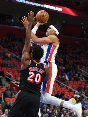 Pistons forward Tobias Harris goes to the basket as Heat forward Justise Winslow defends during the first quarter Sunday at Little Caesars Arena.