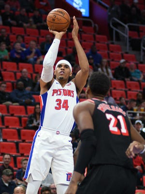Pistons forward Tobias Harris (34) shoots over Heat center Hassan Whiteside (21) during the first quarter of the Pistons' 112-103 win on Sunday, Nov. 12, 2017, at Little Caesars Arena.