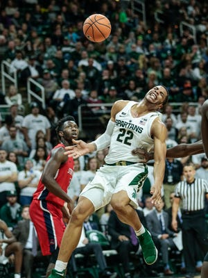 Michigan State's Miles Bridges (22) reacts as he falls on the court during the second half of MSU's 93-71 win over Stony Brook on Sunday, Nov. 19, 2017, at Breslin Center.