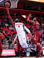Pistons center Andre Drummond (0) makes a layup against Cavaliers forward Jae Crowder (99)  during the first half on Monday, Nov. 20, 2017, at the Little Caesars Arena.