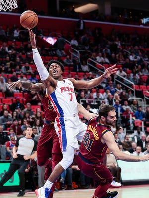 Pistons forward Stanley Johnson (7) makes a layup against Cavaliers guard Jose Calderon (81) during the first half on Monday, Nov. 20, 2017, at the Little Caesars Arena.