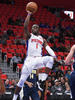 Reggie Jackson goes to the basket against the Nuggets during the third quarter of the Pistons' 103-84 loss on Tuesday.