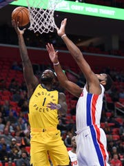 Pacers guard Lance Stephenson (1) lays it up as Pistons