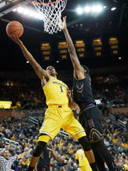 Michigan guard Charles Matthews (1) shoots against