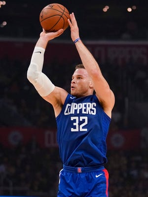 Jan 6, 2018; Los Angeles, CA, USA; Blake Griffin shoots against the Warriors during the first half at Staples Center.