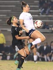 Redwood's Jill Nelsen battles for possession against